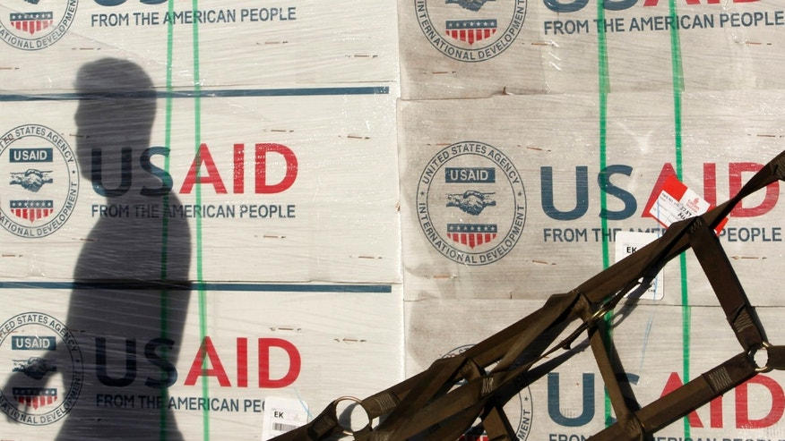 The shadow of a Philippine Army personnel is cast on boxes of relief items from U.S. Agency for International Development (USAID) for the victims of super typhoon Haiyan, at Villamor Air Base in Manila November 13, 2013.