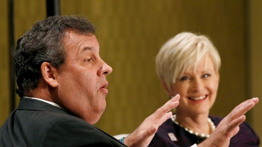 FILE: Nov. 22, 2013: GOP New Jersey Gov. Chris Christie, left, talks to Cindy McCain, wife of GOP Sen. John McCain, at a forum in Phoenix, Ariz.
