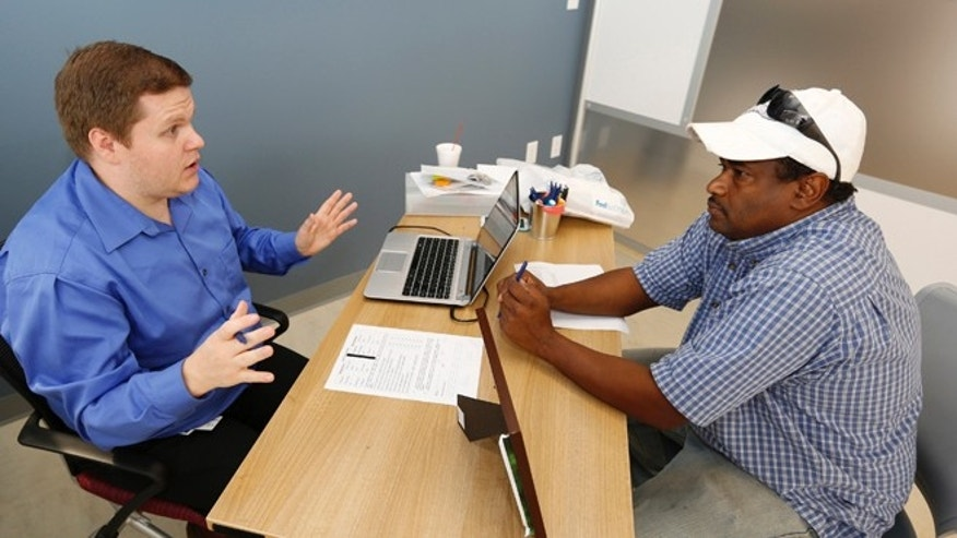 FILE: A certified application counselor for ObamaCare at the Borinquen Medical Center in Miami, Florida.
