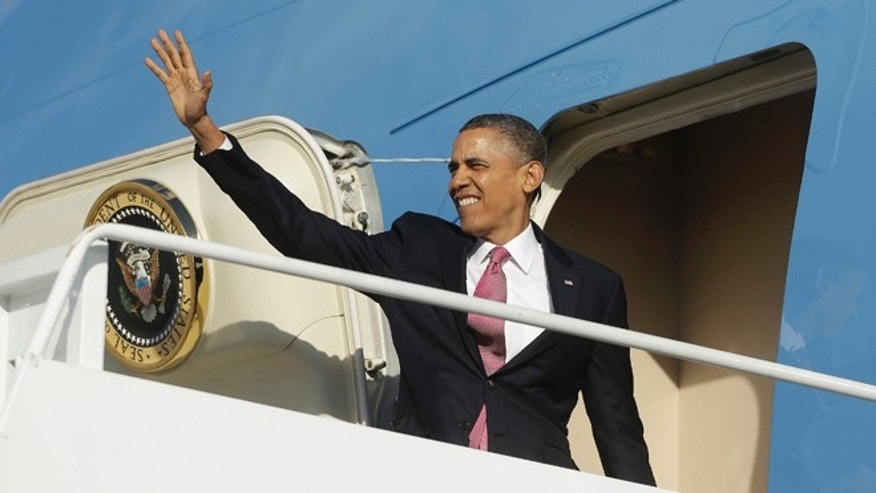 Sunday, Nov. 24, 2013: President Obama boards Air Force One from Andrews Air Force Base, in suburban Maryland.