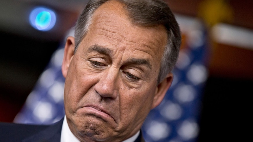 House Speaker John Boehner of Ohio pauses while meeting with reporters, on Capitol Hill in Washington, Thursday, Nov. 21, 2013, before Congress leaves for a two-week Thanksgiving break. (AP Photo/J. Scott Applewhite)
