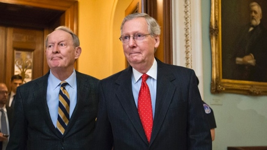 FILE: Nov. 21, 2013: Senate Minority Leader Mitch McConnell, R-Ky., and Sen. Lamar Alexander, R-Tenn., left, leaves the chamber to speak to reporters on Capitol Hill, in Washington, D.C.