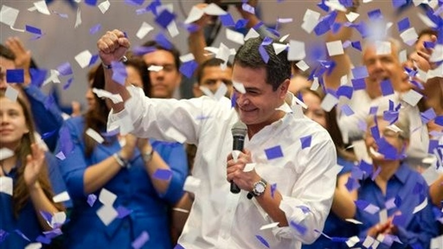 National Party's Juan Orlando Hernandez after partial election results in Tegucigalpa, Honduras, Sunday, Nov. 24, 2013.