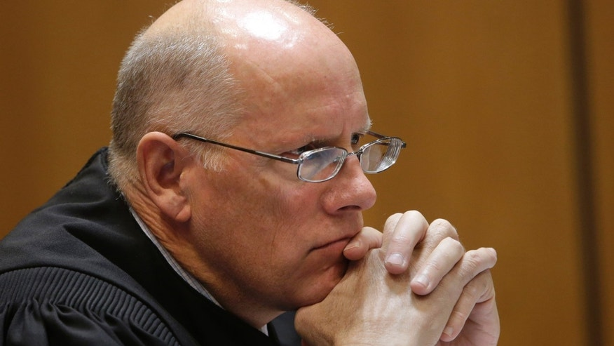 In this photo taken Nov. 8, 2013, Sacramento County Superior Court Judge Michael Kenny listens to arguments concerning a lawsuit to halt funding for California's high-speed rail.