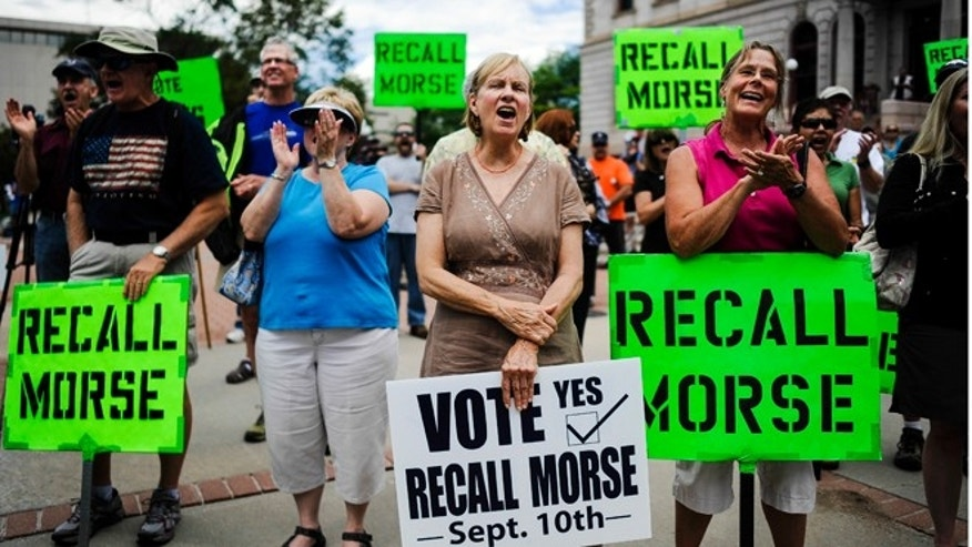 FILE: Sept.  4, 2013: Supporters of the recall election to oust state Senate President John Morse rally outside the Pioneer Museum in Colorado Springs, Colo.
