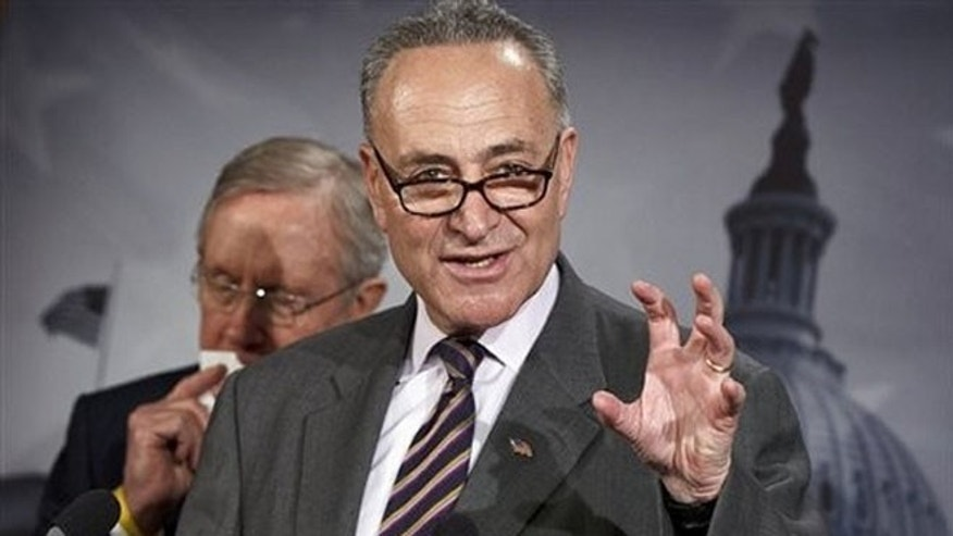 FILE: March 8, 2012: Sen. Charles Schumer gestures during a news conference on Capitol Hill in Washington.