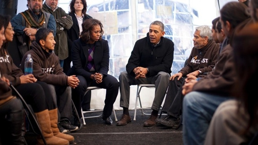 President Obama and the First Lady visit with individuals who are taking part in Fast for Families on the National Mall in Washington, Friday, Nov. 29, 2013.