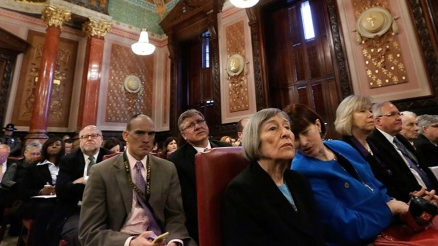 Dec. 3, 2013: Illinois Rep. Barbara Flynn Currie, D-Chicago, front left,  and Illinois Sen.  Heather Steans, D-Chicago, right, talk while attending a Pension Committe hearing at the Illinois State Capitol.