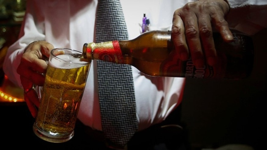 Aug. 28, 2013: A bartender pours beer at a restaurant in Mumbai.