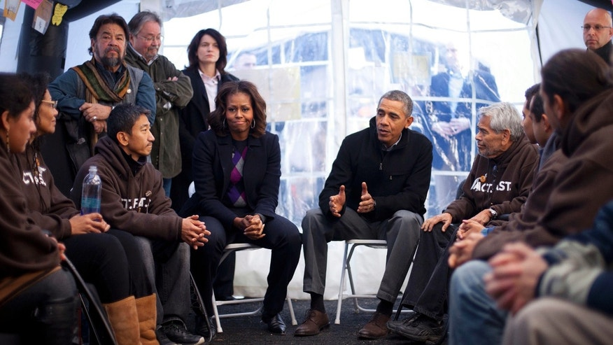 President Obama and the First Lady visit with individuals fasting on the National Mall in Washington, on Nov. 29, 2013.