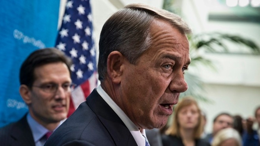Dec. 3, 2013: House Speaker John Boehner and other House GOP leaders meet with reporters following a closed-door strategy session on Capitol Hill.