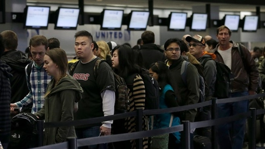 Shown here are passengers waiting at the San Francisco airport on Nov. 28, 2013. While Thanksgiving travel was rough this year, the FAA was earlier this year given the flexibility to end air traffic controller furloughs.