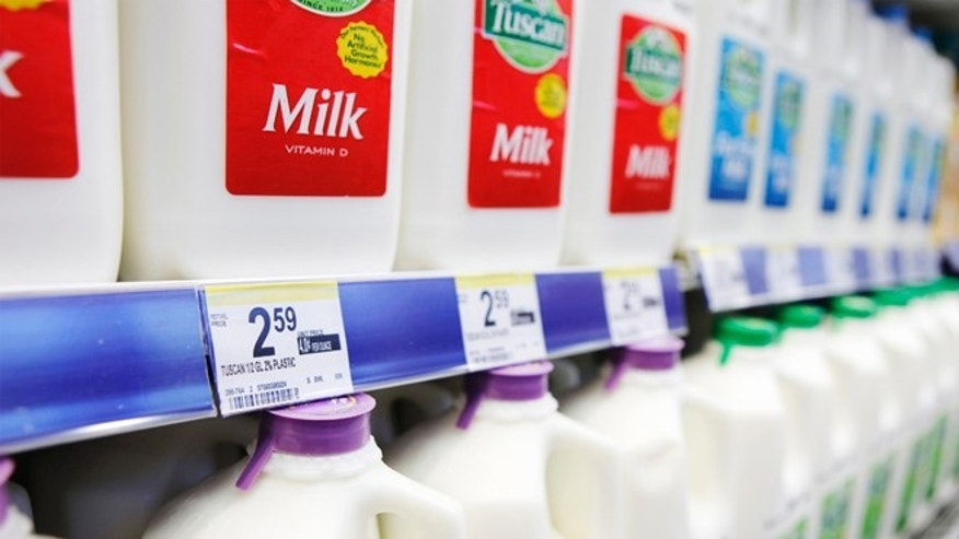Price labels of half gallons of milk for sale are seen in a store in New York April 7, 2011.