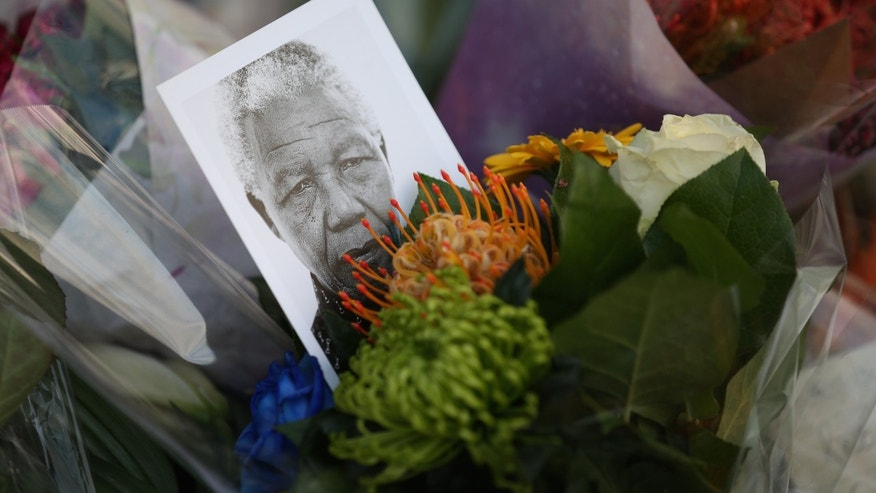Tributes to Nelson Mandela outside the South African embassy near Trafalgar Square on December 6, 2013 in London, England.