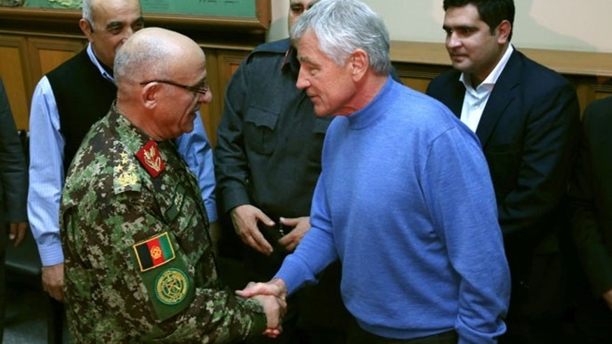 Dec. 7, 2013: U.S. Secretary of Defense Chuck Hagel, right, shakes hands with Afghan Gen. Sher Mohammad Karimi, left, during a meeting at the International Security Assistance Force Headquarters (ISAF) in Kabul, Afghanistan.