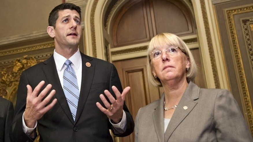 FILE - In this Oct. 17, 2013, file photo, House Budget Committee Chairman Rep. Paul Ryan, left, R-Wis., accompanied by Senate Budget Committee Chair Sen. Patty Murray, D-Wash., speaks on Capitol Hill in Washington where they outlined their approach to tackling the nation's debt problems. (AP Photo)