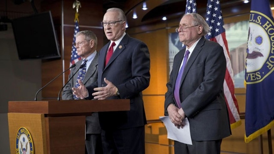 "December 9, 2013: House Armed Services Committee Chairman Howard P. ""Buck"" McKeon, R-Calif., center, joined at right by Senate Armed Services Committee Chairman Carl Levin, D-Mich., right, with Sen. James Inhofe, R-Okla., left, the ranking member of the panel, tells reporters they have reached an agreement on funding the Pentagon budget. (AP Photo)"
