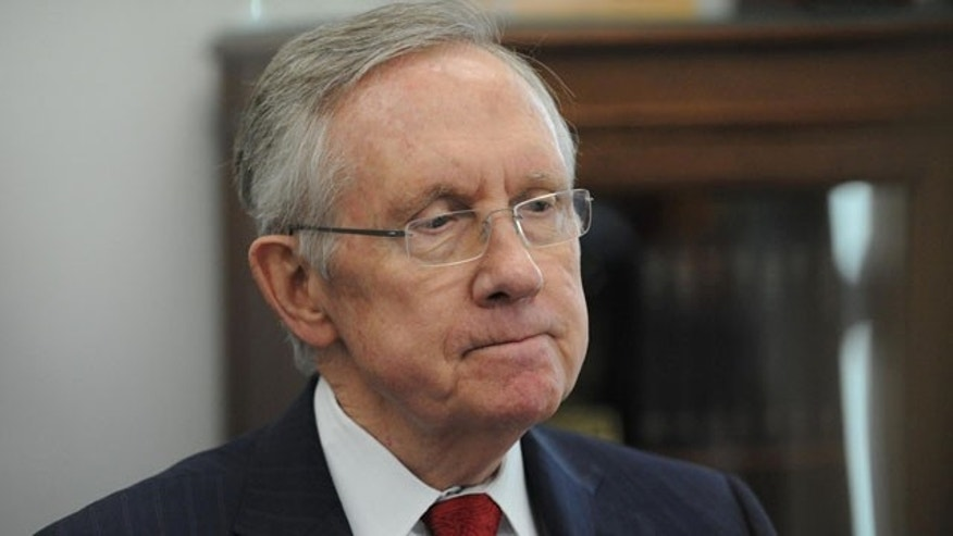December 5, 2013: Senate Majority Leader Harry Reid, D-Nev. ponders a question during an interview in his office in Reno, Nev. (AP Photo/Reno Gazette-Journal, Andy Barron)