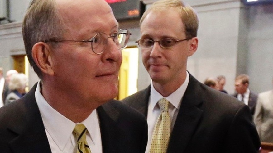 Jan. 9, 2013: Sen. Lamar Alexander, R-Tenn., left, leaves the Tennessee House of Representatives chamber with his chief of staff, Ryan Loskarn, right, in Nashville, Tenn.