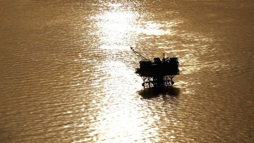 NEW ORLEANS - APRIL 28:  Oil platforms sit in the Gulf of Mexico near the Louisiana coast line on April 28, 2010.   (Photo by Chris Graythen/Getty Images)