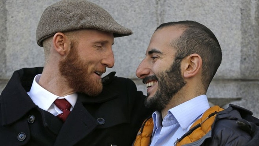 Derek Kitchen, left, and his partner Moudi Sbeity look at each other following court on Wednesday, Dec. 4, 2013, in Salt Lake City.