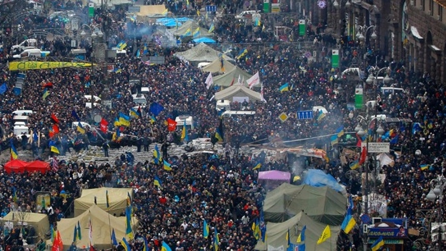 Dec. 15, 2013: Pro-European Union activists gather during a rally along a main street towards Independence Square in Kiev, Ukraine. About 200,000 anti-government demonstrators converged on the central square of Ukraines capital Sunday, a dramatic demonstration that the oppositions morale remains strong after nearly four weeks of daily protests.