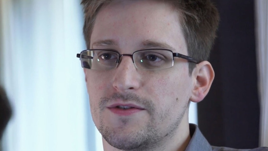June 9, 2013 file photo provided by The Guardian Newspaper in London shows National Security Agency leaker Edward Snowden, in Hong Kong.
