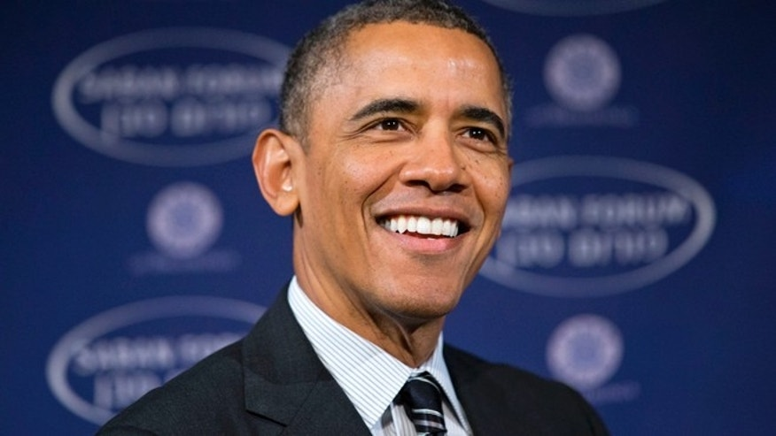 Dec. 7, 2013: President Barack Obama smiles as he arrives at the  Saban Forum to speak about the Middle East at the Willard Hotel in Washington.