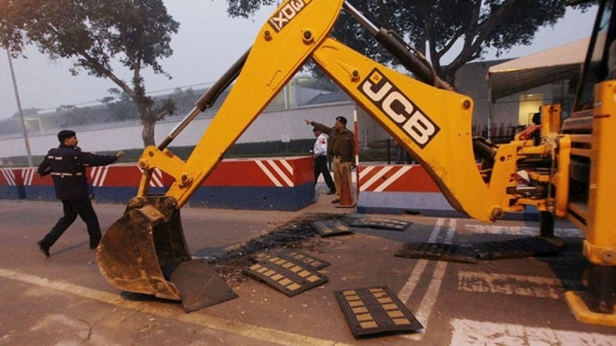 Dec. 17, 2013: Indian police remove barricades that had been erected as a safety measure outside the main entrance of the U.S Embassy in New Delhi, reportedly in retaliation for the alleged mistreatment of an Indian diplomat.