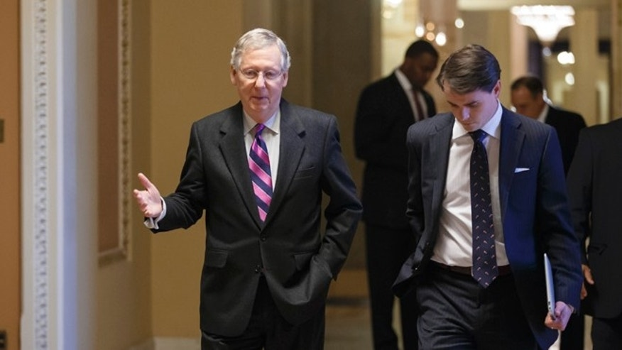 Dec. 18, 2013: Senate Minority Leader Mitch McConnell, R-Ky., walks to the chamber for the final votes on the bipartisan budget deal.