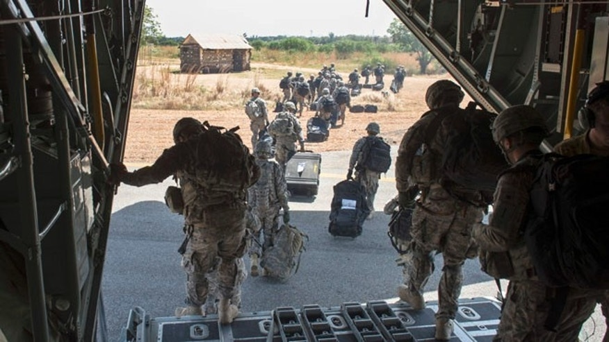 Dec. 18, 2013: In this photo released by the U.S. Air Force, soldiers of the East Africa Response Force (EARF), a Djibouti-based joint team assigned to Combined Joint Task Force-Horn of Africa, depart from a U.S. Air Force C-130 Hercules in Juba, South Sudan to support with an ordered departure of personnel from the city.