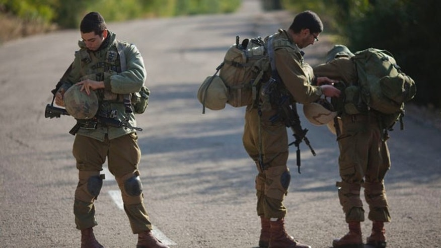 Dec. 16, 2013: Israeli soldiers stand guard in Rosh Hanikra, Israel, near the border between northern Israel and Lebanon.