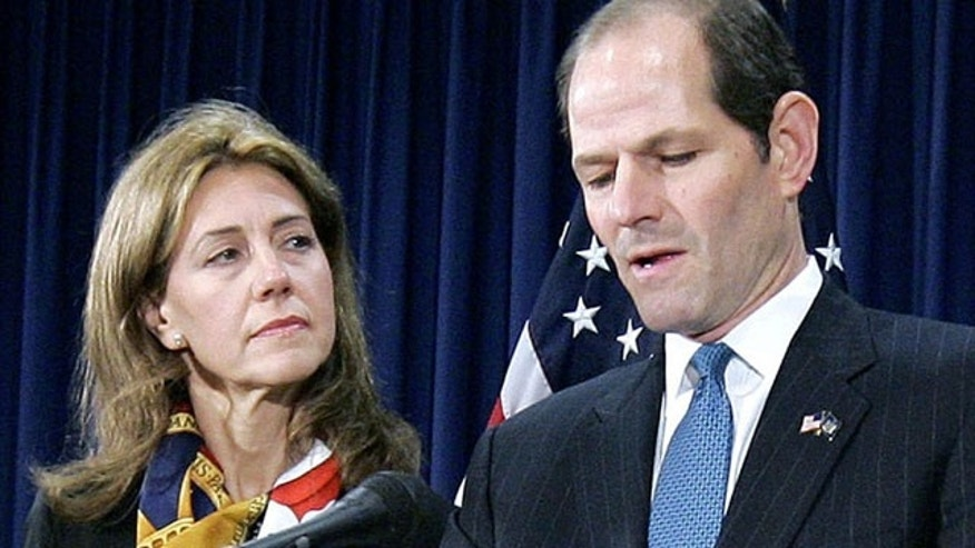 FILE - In this March 12, 2008, file photo, New York Gov. Eliot Spitzer announces his resignation amid a prostitution scandal as his wife Silda stands by at the governor's office in New York. Spitzer and wife Silda Wall Spitzer announced Tuesday, Dec. 24, 2013, that their marriage of more than two decades is over. (AP Photo/Stephen Chernin, File)