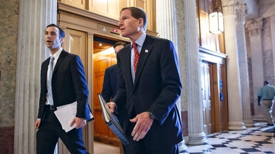 Dec. 18, 2013: Sen. Richard Blumenthal, D-Conn., right, walks to the Senate chamber on Capitol Hill.
