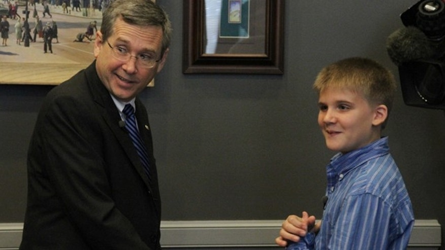 Aug. 8, 2013: U.S. Sen. Mark Kirk visits with Jackson Cunningham in his office in Washington.