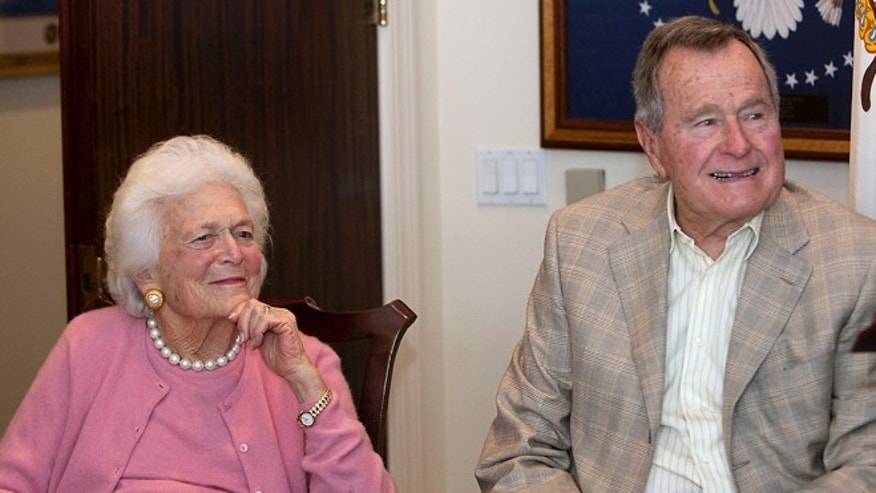 Dec. 23, 2013: Former first lady Barbara Bush, left, and former President George H. W. Bush look on during a ceremony at President Bush's office in Houston.