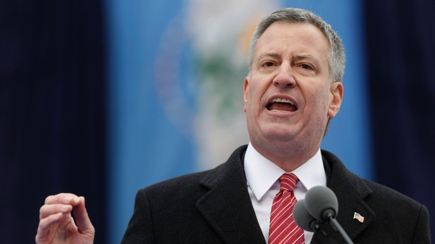 New York City Mayor Bill de Blasio speaks after being sworn in during the public inauguration ceremony at City Hall in New York, Wednesday, Jan. 1, 2014. (AP Photo/Seth Wenig)