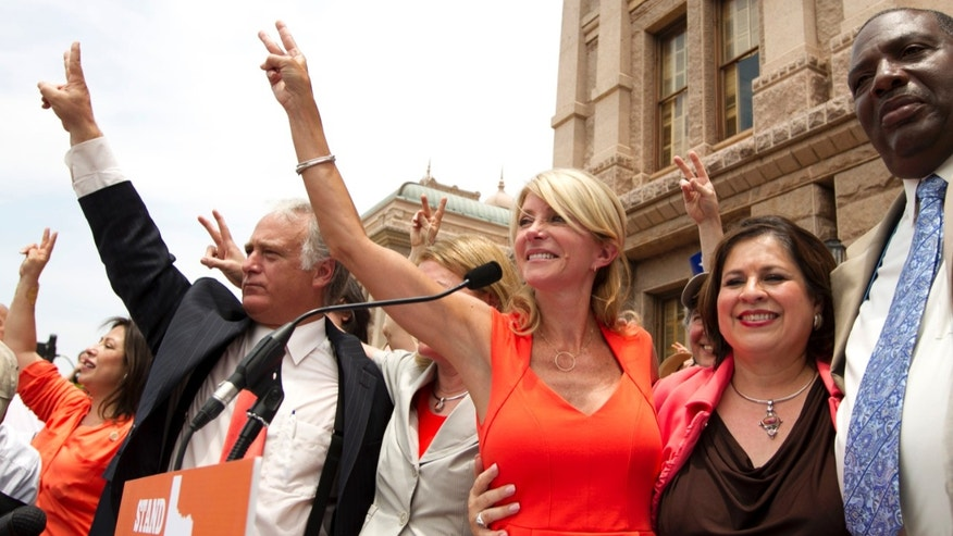Democratic state senators Kirk Watson, Wendy Davis, Leticia Van de Putte and Royce West on July 1, 2013 in Austin, Texas.