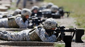 Sept. 18, 2012: Female soldiers from 1st Brigade Combat Team, 101st Airborne Division train on a firing range while testing new body armor in Fort Campbell, Ky., in preparation for their deployment to Afghanistan.