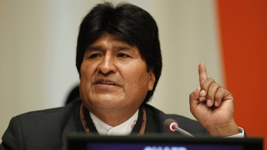 In this photo provided by the United Nations, Evo Morales Ayma, President of the Plurinational State of Bolivia, speaks at the handover ceremony of the Chairmanship of the Group of 77 at United Nations headquarters, Wednesday, Jan. 8, 2014.  (AP Photo/The United Nations, Paulo Filgueiras)