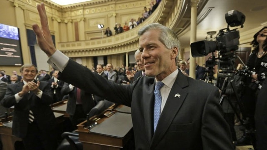 January 8, 2014: Virginia Gov. Bob McDonnell waves to the crowd after delivering his final State of the Commonwealth address before a joint session of the 2014 General Assembly at the Capitol in Richmond. McDonnell leaves office on Saturday. (AP Photo/Steve Helber)