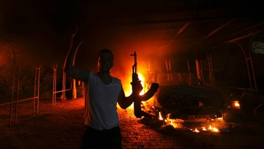 Sept. 11, 2012: A protester reacts as the U.S. Consulate in Benghazi is seen in flames.