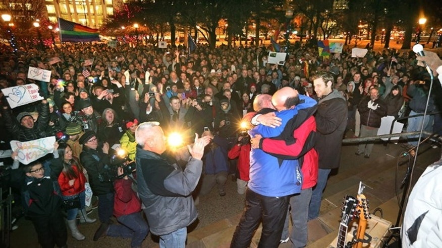 Dec. 23, 2013: Dan Trujillo, left, and Clyde Peck get married as about 1,500 people gather to show support of marriage equality at Washington Square, just outside of the Salt Lake City and County Building in Salt Lake City.
