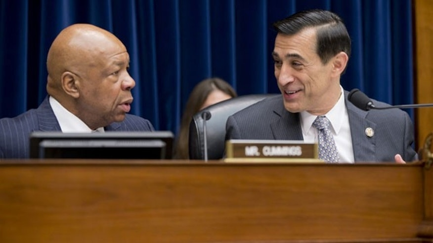 FILE - In this Dec. 4, 2013, file photo, House Oversight and Government Reform Committee Chairman Rep. Darrell Issa, R-Calif., right, confers with the committee's ranking Democrat, Rep. Elijah Cummings, D-Md., on Capitol Hill in Washington, before the start of the committee's hearing on the implementation of the Affordable Care Act's HealthCare.gov website. (AP)