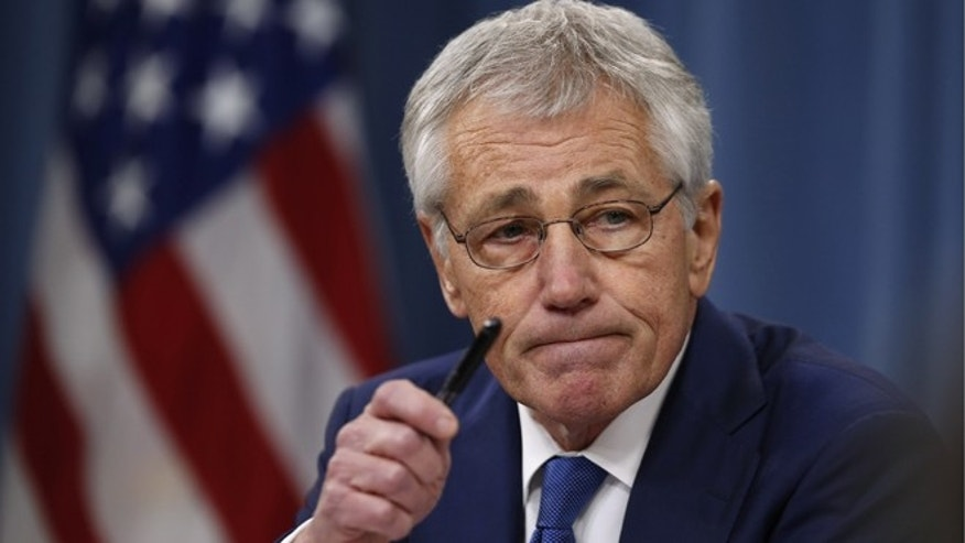 Dec. 19, 2013: Defense Secretary Chuck Hagel takes questions as he briefs reporters at the Pentagon in Washington.