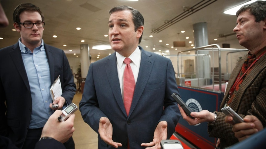 Sen. Ted Cruz, R-Texas, speaks with reporters as he arrives at the Capitol for the Senate vote to approve a $1.1 trillion spending package, the Omnibus Appropriations Act, a bipartisan compromise that all but banishes the likelihood of an election-year government shutdown, at the Capitol in Washington, Thursday, Jan. 16, 2014. The legislation is a follow-up to the budget compromise the two parties pushed through Congress in December that set overall spending limits for the next two years.   (AP Photo/J. Scott Applewhite)