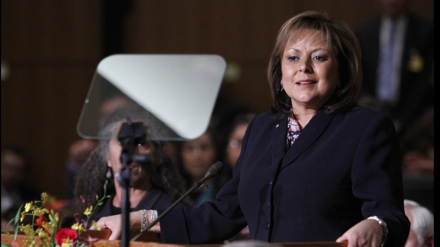 Gov. Susana Martinez delivers the State of the State address at the State Capitol on Tuesday, Jan. 21, 2014, in Santa Fe, N.M. (AP Photo/The Santa Fe New Mexican, Luis Sanchez Saturno)