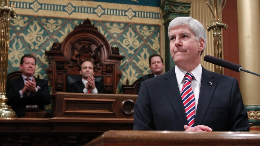 Senate Majority Leader Randy Richardville, R-Monroe, from left, Lt. Gov. Brian Calley, and House Speaker Jase Bolger, R-Marshall, applaud as Michigan Gov. Rick Snyder, right, delivers his State of the State address to a joint session of the House and Senate, Thursday, Jan. 16, 2014, in the House Chambers of the state Capitol in Lansing, Mich. (AP Photo/Al Goldis)