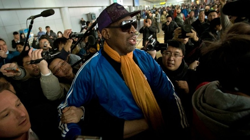 Jan. 13, 2014: Former NBA basketball player Dennis Rodman is followed by journalists as he arrives at the Capital International Airport in Beijing from Pyongyang.