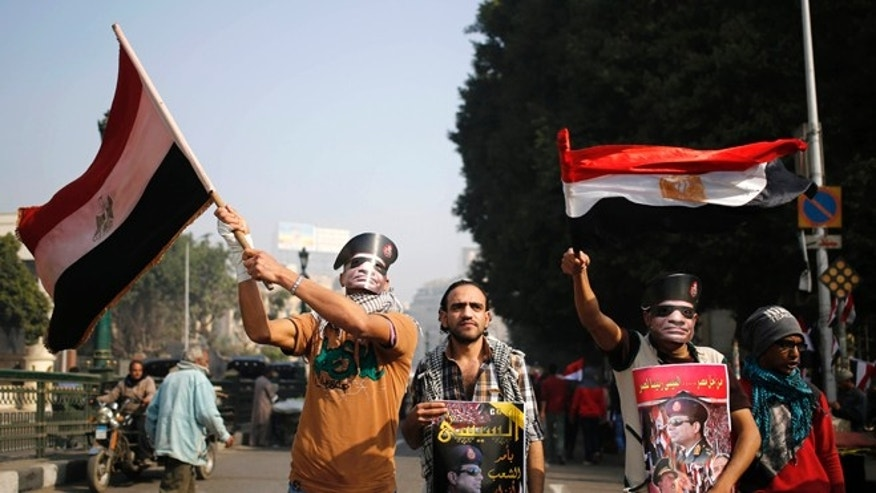 Saturday, Jan. 25, 2014: Egyptians wear masks of Defense Minister Gen. Abdel-Fattah el-Sissi, in Tahrir Square, in Cairo, Egypt.